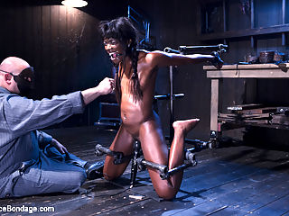 Full Throttle - Ebony Babe Suffers Beautifully : Ebony babe, Ana Foxxx, is put in compromising positions and tormented. She is stretched out with her hands above her head, spread wide on her back, and then put into a compact position to enhance her suffering.
