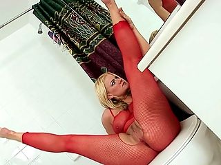 Racy in Red : Zeta Kellie is a blond stunner with full, thick legs and thighs, which she happily showcases for you in a bright red fishnet body stocking. The netting bulges every time she moves and her zaftig legs threaten to rip through the stringy material. Watch as she touches herself and sits in the tub, wet body stocking still clinging to her voluptuous curves and then suds her feet and legs and shakes her big, round ass. A dirty lady getting clean never looked so good.