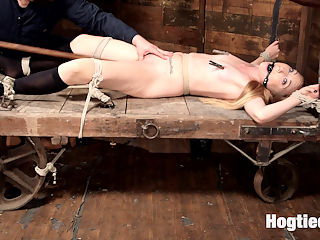 Sexy Blonde with Little Tits Manhandled! : The Sarge manhandles petite blonde Emma Haize. Emma Loves being handled and used by big burly guys, and Sarge gives it to her just the way she wants it. Rolled in and objectified on a farm cart, arms stretched tight overhead, ass spanked red, plenty of orgasms and tight crotch ropes.