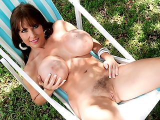 Stacked In Swimsuits : Shelby Gibson, iSCOREi WILF, introduced herself with a bra and panties show and also surprised everyone with a bushy pussy in a time when most models have a close shave. She returned to bust out in tight tops.br br Now the former Hooters waitress and wife of a longtime iSCOREi magazine reader shows her moves in a variety of extreme swimsuits. Would Shelby actually wear these at a public beach or pool? Would she wear them at a private resort? Would she even wear them at all in any kind of public place?br br Yes to all of the above! Shelby is a woman who is proud of her super-slim and super-stacked figure and proud to show it at iSCOREi. Because Shelby wanted to and her hub is a very generous member of the Boob Brotherhood. We know that many husbands wouldnt want their busty wives to model for anyone but themselves at home.br br A beaming Shelby talks about how she feels when guys check her out. Some whistle. Some bark. Some try to chat her up. They all do double or triple takes regardless of the sounds they might make. Sometimes the women can be catty and jealous, something many other iSCOREi Girls have faced.br br We asked Shelby about the suits she wears in this scene and other important questions. br br iSCOREi Shelby, out of the swimsuits you modeled, which one was your favorite, if any, and why?br br bShelby The white one and the blue one were my favorites. They made me feel incredibly sexy and desirable.bbr br iSCOREi Which ones would you never wear in public?br br bShelby The red microkini was fun for the shoot but I would never wear it in public.bbr br iSCOREi Which suits would you wear to a resort for adults or a private beach or pool?br br bShelby I would definitely wear the white one and the blue oneb.br br iSCOREi Whats your favorite style of swimsuit, in general?br br bShelby The right monokini emphasizes my assets the best.bbr br iSCOREi Have you ever worn any suits like these to a public beach? If you did, what kind of reactions did you get?br br bShelby Yes, Ive worn monokinis like the blue one on the beach. Its a lot of fun because I get lots of head turning and long looks. LOTS of attention!bbr br iSCOREi What companies and brands do you buy your swimsuits from?br br bShelby Custom-made is really my only option because off the rack just doesnt fit.bbr br iSCOREi Do you do a lot of bikini modeling at home for fun, indoors or outdoors?br br bShelby Some. Its so much fun and a real turn-on. bbr br iSCOREi Do you always wear heels with your swimsuits?br br bShelby Not on the beach of course but heels are good on the way to the beach and after. I get even more attention!b br br iSCOREi What criteria does a suit need to meet before you buy it?br br bShelby It needs to turn heads and drop jaws! bbr br iSCOREi Thank you, Shelby!br