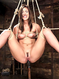 All Natural Beauty in Pile Driver Orgasm Overload : Tall, long legged all natural beauty Rilynn Rae is back on HogTied for her dose of super tight inescapable bondage and orgasm overload. Her innocent white dress belies the slutty pussy underneath, and we see to it that she gets all the perverted attention she can handle. Ball gags and nipple suckers round out an ice torment session that freezes her clit before cruel vibrations send her into spasming orgasms. Suspended pussy fucking highlights the session ending with a swollen, squirting pussy and an extremely satisfied bondage slut.