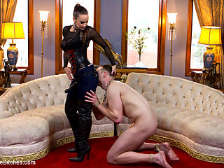 Prostate Milking In Musky Blue Jeans : Divine Bitch, Mistress Bella Rossi, shows up to the Armory in her tight blue jeans and decides to wear them for the shoot! She was sweating in these skin tight suckers all the way to the Armory and they are nice and musky and drenched for her slave. Her tall black leather boots drive him nuts until he is basically humping her leg like a poor dog. Mistress Bella milks his prostate until cock filth wont stop dripping from his cock then fucks his dick until she gets off and makes him spill his fat load all over her black leather boots!