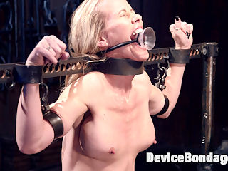 MILF gets tormented and machine fucked : Simone is put in grueling positions that leave her helpless to the desires of her captor. She is tormented in ways that she didnt know were possible and made to cum harder than she ever has before.