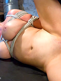 The Restless Whore : Blonde MILF Abbey Brooks is Bill Baileys play thing. She is there solely for his twisted entertainment. See Abbey get tied up, flogged, spanked, fucked and made to be submissive. She cant get enough of Bills big cock.