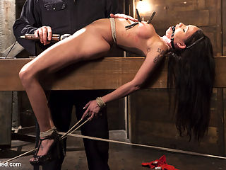 Big tit Brunette caught in brutal bondage. : Raven finds herself at the hands of a sick fuck who has his way with her. She is bound tightly and tormented until her captor decides to let this slut cum.