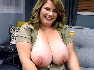 Busty Army Brat : Watching a girl like CJ Woods get into and out of tight tops and low-cut outfits is a treat. Honestly, we could watch a gal like her stuff her sweater meat into bras and tops all day and never get tired of it.br br Thats one of the downfalls about having big boobs, CJ said. Its hard trying to find something that fits.br Oh, thats hardly a downfall, CJ. Not in the least. Every push, tug and tuck is more than worth it when youre finally dressed and showing off that mouth-watering cleavage.br br Theyre just a bit out of control, CJ adds. But I do have amazing cleavage.br br Fellas, if youve ever complained about your wife or girlfriend taking too long to get dressed, you must not have nabbed a buxom girl like CJ. This is a must-see event.