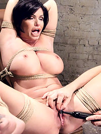 Bound Huge Fake Tit MILF : Big fake tits are the order of the day on HogTied. Gorgeous MILF Shay Fox endures tough bondage positions whiles begging and pleading for the orgasms to stop