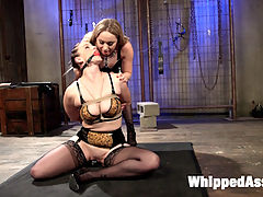 Knock That Domme Down A Notch! : Bella Rossi needs to be knocked down a notch since her elevated status as a domme on Whipped Ass. No one is more suited to remind Bella where she came from than Aiden Starr. Bella easily reverts back to her submissive ways trying to catch orgasm after orgasm with her vibrator. Aiden punishes Bella with anal training, spanking, pussy clamps, exercise in bondage and strap-on sex!