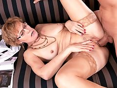 The art of the first on-camera fuck : Georgina, a 58-year-old mother and divorcee, makes her 50PlusMILFs.com video debut by sucking and fucking her art student. Hes 26 years younger than her. She could teach him a thing or two about art and sex. But its the sex were most-interested in, right? Right. And Georgina is very good at that. Her oral skills are exceptional. She goes deep on the cock and gets it very wet. When a 58-year-old gives sloppy blow jobs, you know youve found a winner.br br Georgina enjoys gardening. She says she has to wear a bra because my nipples are so big. Heck, we think thats a good reason to not wear one. She likes romantic dates such as going to restaurants and going for long walks. She a swinger. Shes been in a few three-ways and enjoyed them. She loves cum.br br Sounds like she came to the right place. Youll be seeing more of her.