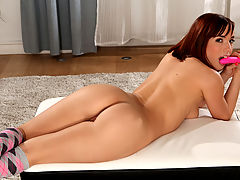 Redhead hottie with a tight smackable ass strips everything off but her knee high socks and then reaches in from behind to tease and fuck her juicy pussy with a vibrating toy