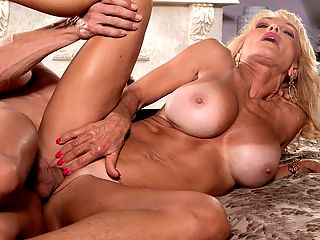 MILF of the Month : The MILF of the Month is the amazing over-60 busty blonde Cara Reid who is getting the shaft from Tony DeSergio. The kind of shaft thats very good for her.br br How did Cara get here?br br My friend Sally DAngelo, said Cara. I love me some Sally. I didnt know anything about this. She was reluctant to bring it up. She didnt want me to think badly of her, but I told her I thought it was awesome! Then she said that I would be perfect, and I told her, Let me think about that. One thing led to another. I took photos then I got a phone call two days later, and so it began.br br So, to sum up, Cara is buddies with Sally DAngelo. They are friends who ride motorcycles together with their spouses. Cara didnt know that Sally is a porn star or that Sally and her husband are swingers. Sally didnt know that Cara and her husband are swingers. When Cara learned Sally was more than a swinger and is a porn star, the wheels spun into third gearbr br I lived a very sheltered life so I think this is wild. 15 years ago I met my second husband. He opened my eyes to all kinds of things. I had a Southern upbringing with the bible, church, things like that. As I was growing up I would feel things inside, but society says that ladies dont do things like that. I was raised like that. But then when I met my second husband he said he saw in me something that I wasnt aware of. It had been repressed.br br Repressed no more!br