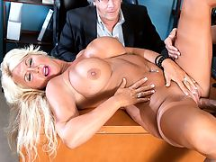 Annellise and the cuckold : First, we see Roger showing up at the office and asking the secretary if his wife is in. Then we see Annellise Croft moaning while stuffing her mouth with cock. Its obviously not her husbands cock.br br Your husbands here, the secretary asks. What should I do?br br Send him in! Annellise says.br br The secretary sends him in, and what does he see? His 50-year-old wife sucking a big, fat cock and really getting into it.br br Annellise! Roger says.br br Roger, what are you doing here? Come in and sit right down. How does this make you feel?br br What are you doing? Roger says.br br I know how you like to watch, Annellise says, so just sit there and watch me.br br So he does as hes told, and he keeps moving his head to get a good view of his wife sucking a strangers cock. Is he into this or is he humiliated?br br Look at this, Annellise says. His cocks so much bigger than yours.br br Well, if he wasnt humiliated before, he is now.br br After Annellise sucks his cock, she goes up to Roger and says, Im gonna cum, and theres nothing you can do about it.br br He doesnt even try. He just sits there and watches as his blond, big-titted, long-nippled wife gets fucked every which way, and then Annellise puts her cum-soaked face in Rogers face and says, I did it for us, baby!br br The secret to a long-lasting marriage? Maybe.br br I did it for you, she says.br br Somehow, we doubt that. But she might have done it for us.