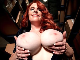 Boob Warehouse : Its a boob-cam show in our warehouse with hot, hot, hot redhead Red Vixen, the sexy wife of a iSCOREi reader. He encouraged Red to model in the first place. Shes not a nudist or an exotic dancer. It took her husband a while but he finally got Red to submit her shots to iSCOREi. She delayed that for some time. Not every reader with an attractive busty wife wants her to show her body off for the camera and not every wife of a reader wants to model. Thats why iSCOREi WILFs are special and far and few between.br br Red is easy-peasy about modeling in the future. Wherever it takes me, says Red. Im not a planner, but thats where my husband and I are so different. Whatever happens, happens.