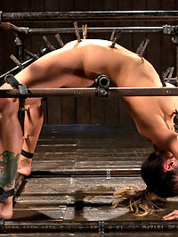 Big Tits Tormented in Demented Device : Big titted Nadia Styles submits to Orlando and his brutal bondage box. She is contorted, stretched out, and fucked every way this sadistic fuck can imagine. Squirting orgasms, anal fucking, and brutal bondage leave this slut begging for more.