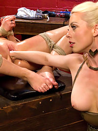 AJ Applegate Flogged, Fisted and Anally Strap-on Fucked by Lorelei Lee : Hot blonde AJ Applegate finds herself under the control of dominatrix Goddess Lorelei Lee. Trapped in her cage, AJ is caned before shes released, only to be flogged and spanked. Lorelei subjects AJ to some erotic humiliation by making her piss in her bondage and all over the floor. Lorelei then shoves AJs toes and foot up her cunt before fucking her foot to orgasm. Bound and helpless, AJ takes Loreleis whole fist and comes all over her hand. Finally a good hard lesbian anal strap-on fucking concludes a smoking hot BDSM scene between two gorgeous women!