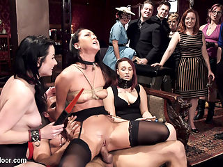 Twin Set of Raven Haired Slaves Service Brunch Guests : Elegant head slave Veruca James guides her slave trainee Sabrina Banks in how to please a crowd of brunch guests using grace, humor, and relentless orgasms. One special guest is to have his massive cock entertained, and our submissive slave girls set to work with well trained blow jobs, strenuous cowgirl fucking, and anal in strict rope bondage. First scene places Veruca and Sabrina in a orgasm competition of the worst kind. Placed in metal bondage with no escape, vibrators latched firmly on their pussies, the slave girls scream for relief and pour sweat and orgasms as our guests cheer them on and enjoy their champagne. Thoroughly wrecked, Veruca comes out victorious and is carried to the lounge for her reward Karlos thick cock deep in her ass.Veruca makes good use of her trainee Sabrinas face, using it first to wet her ass and pussy, then to get Karlos dick rock hard. Sabrinas obediently plays fluffer as Veruca takes a hard pounding tied firmly in place, suffering through several more orgasms until Karlo is satisfied. Meanwhile, guests have become more than rowdy and come alive in a kinky orgy of tight rope suspensions, electrical play, blow jobs, wrestling and corporal. It is time for Veruca to show her ability to train a new girl, and she mounts her charge on Karlos hard dick for disciplined reverse cowgirl fuck. The crowd finds this show very appealing, and gather around to encourage and tease Sabrina as her thighs weaken and her pussy cums under threat of electrical torment by Verucas hand. Veruca shows her sadistic side with a gleeful grin, and is rewarded by being thrown face down on the couch and covered in cum with her trainee.