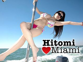 A Day on The Water : Her huge natural boobs spilling out of the sides of her too-small bikini top, Japans top bust star Hitomi gets to spend a real Miami day out on the water. Speeding along in a power cruiser, Hitomi and her iSCOREi friends head to a little-known, odd site explored a few years ago in a public-television film.br br Built in the 1930s, Stiltsville is a deserted group of wood shacks and houses built on stilts one mile south of Cape Florida on the sand banks of the Safety Valve near Biscayne Bay in Miami. At one time, it boomed with salty dudes and mermaids.br br Hitomi pilots the speeding boat for a while, the first time shes ever done this. She hands the wheel over to the captain and goes aft to pole dance as they skim across the water. Hitomi is a very good, sexy pole dancer! The boat skims over the water as Hitomi slides and climbs the pole with skillful moves.br br Once they get to one of the Stiltsville houses, Hitomi explores the history-rich structure as the camera explores Hitomis incredible body. She sucks and plays with her big boobs and roams the decks as we roam Hitomis body. The Magic City across the water is an impressive sight behind her but nowhere near as impressive as the natural wonders of this girl named Hitomi, on the loose in Miami.br