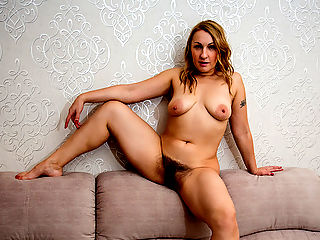 Mature mom with soft curves and all natural boobs strips naked on camera for the first time and spreads her hairy twat for some self induced pleasure