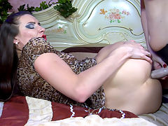 JeanA and BertieA amazing anal lesbian action : Lesbian Jean A and Bertie A are dressed like twins in similar animal print dresses and black lacy holdups, but only one of them is armed with a rubber fuck toy. Watch the willowy raven-head getting bent down by the curvy anal-loving redhead for some ass licking and poking before the last puts to use her butt-splitting toy. She cornholes her girlfriend from behind before spread-eagling and folding her in two on the bed.
