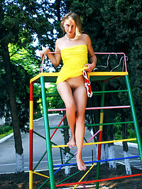 Peeking on the playground : This slender teen likes to play around and let you peek on her pussy before she shows it herself in this photo shoot.
