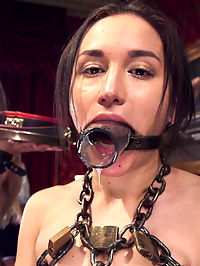 Disorderly Anal Slaves Disciplined : Its a beautiful Sunday Brunch and The House is packed with our most salacious local BDSM players. Service should be impeccable, with senior house slaves Darling and Gabriella on hand.Their only job is to handle 19 year old all natural newbie Sydney Cole and serve strawberries, blow jobs, entertaining orgasms, and let the guests clamp their tits. Quickly the Stewards orderly celebration is in ruin. Gabriella cant stop smirking with a hard cock in her mouth, the new girls squeaks like a mouse when she cums, and Darling keeps losing the butt plug out of her slutty ass while serving strawberries. Embarrassed by this display of inept delegation and grace, the Steward seizes Gabriellas collar and placed her in heavy chains as the Drool Slave. If she cant stop smirking, her mouth will be of use lubing Darlings ass for a punishment fucking. Darling has lost her collar as well and as is strung up in a brutal suspension to be used anally by our horny house guest. Once Darling has suffered beautifully and earned her place as senior slave back it is Gabriellas turn to be stuffed with dick in tight leather restraints. Gabriellas shocked face is priceless as she takes a monster cock in her ass and apologizes for her smirking ways. Meanwhile, Darling tries to prepare Sydney for sexual service by teaching her rules with a vibrator and crop. Guests become horny and create a series of rousing BDSM play scenes with rope bondage, paddling, CBT, and blow jobs. Once Gabriella and Darling are both back in their collars, having suffered and apologized appropriately, they finish the day teaching innocent little Sydney how to keep the crowd happy and make a cock cum.