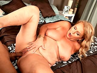 Thousands of cocks, but her first time on-camera! : I prefer to skip the date and just have sex, said Alice, a 65-year-old wife, mother and grandmother from Las Vegas who, in this scene, skips the date and sucks and fucks 26-year-old Rocky.br br Ill sometimes meet a guy with my husband with the intention of having a threesome. If we meet in a bar that has booths, I like to sit on one side with the guy were meeting, with my husband on the other side of the table. Im usually the first to reach over and touch. I love knowing Im giving a guy an erection. I never wear panties when Im meeting a single guy. Im not sure why since Ive never met a guy who was stopped by panties.br br Rocky isnt stopped by Alices panties. He goes right after her big tits and big ass and sweet pussy. Which is fine by Alice. Shes been a swinger for over 40 years, and she couldnt count the number of guys shes fucked. But this is her first time fucking on-camera.br br Its something new, something different and something fun that makes life exciting, Alice said.br br This video starts with an interview. We get to know Alice and find out about her swinging adventures. Alice is a voluptuous blonde who is very matter-of-fact about sex. She loves to fuck. So what? Rocky shoots his load on her face and the cum gets into her hair. Big deal!br br Well, its a very big deal to us because jacking is a big deal.br br I love being fucked. I prefer to have sex every day, but sometimes it doesnt work out that way. Im definitely sexually assertive. I know what I like and I go after it.br br Thats how she ended up here.