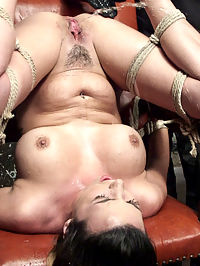 Helpless Squirting Slut : We start with Danica tied with her hands above her head and he legs stretched open. Her clothes are slowly removed to expose her massive tits, tight ass, and hungry pussy. She starts to writhe around knowing that shes helpless to anything that is about to happen to her. She is flogged and then made to cum for the first of many times. Next she is on her back with her legs pulled back to show off her ass. Her feet fall victim to a nasty bastinado with a cane and a crop. Danicas pussy is begging to get fucked, so thats what we do until she has a squirting orgasm. Now that we know she is a squirter, we tie her to a chair with her pussy above her head for some squirt torment. The rest of the day is spent making her squirt into her face and tormenting her helpless little cunt.