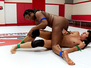 Voluptuous Ebony Rookie takes on skinny rookie with a heart of a fighter : Lisa Tiffian is undefeated this season. She wants to walk through this rookie cup tournament and become a champion her first yet at wrestling. Vivi Marie is one of the most tenacious wrestlers on the roster. She never gives up. She has seen Lisas wrestling videos and knows that Lisas conditioning isnt all that great. Vivi plans on wearing down this big beautiful babe, and taking her town in the final round, hopefully by bringing her to orgasm.