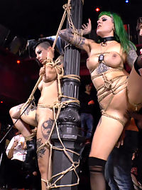 Two Slutty Whores Disgraced in Spanish Extreme Public Orgy! : Legendary Director Steve Holmes has a gift for Mona Wales! Two slutty pain whores to take to the filthiest fucking international orgy of all time! Satrina and Lola are made to grovel like dogs at the feet of devastating Domme Mona Wales and fight over a dirty dildo like the filthy whores they are. This pair of fuck holes is then taken to a Spanish bar packed with riff raff to serve the crowd and compete in the most humiliating slut-off in the world. Finally bound and shut up with throats full of cock, all thats left is a hard, intense fucking to make these ultimate sluts give the crowd what they want!!