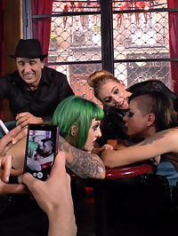 Two Slutty Whores Disgraced in Spanish Extreme Public Orgy! : Legendary Director Steve Holmes has a gift for Mona Wales! Two slutty pain whores to take to the filthiest fucking international orgy of all time! Satrina and Lola are made to grovel like dogs at the feet of devastating Domme Mona Wales and fight over a dirty dildo like the filthy whores they are. This pair of fuck holes is then taken to a Spanish bar packed with riff raff to serve the crowd and compete in the most humiliating slut-off in the world. Finally bound and shut up with throats full of cock, all thats left is a hard, intense fucking to make these ultimate sluts give the crowd what they want!! Be sure to check out how wild this party got with our very special behind the scenes segment on BehindKink.com . Watch what happens at the party while these models are getting tied up!