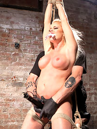 Blonde Bombshell Explodes in Extreme Bondage!! : Welcome Nikki Delano to Hogtied.com. She is 5 ft. tall and stacked in all the right places. She has huge tits, an amazing ass, and such an innocent looking face. Dont be fooled though, because this sexy little blonde slut cant wait to get tied up and tormented. First she is kneeling with her legs spread and her hands above her head the perfect to get at all of her good parts. Her clothes are removed and the we get our first look at her amazing body. We also see how bratty this slut is going to be for the day, which is sadistic inspiration for The Pope.Next we have her bent over with one leg up, exposing her luscious pussy. The tormenting continues with canes, floggers, and some bastinado. Then her pussy is fucked into several screaming orgasms.In the third scene, we have Nikki in a brutal suspension that tests every ounce of her integrity as a bondage model. Her body is abused even more before her tight pussy is filled with a massive dildo that makes her cum uncontrollably. Shes made it this far, so this will be the one that pushes her over the edge. She is completely helpless and her body is terrorized with more pain and suffering. The day ends with orgasms that beyond what shes ever had before.
