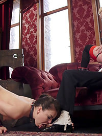 Alpha Sex Slave Returns to Train Anal Rookie : Cherry Torn, the bombshell Alpha Slave from the original House Staff, returns to brutalize, humiliate, and fuck a domestic servant gone astray. Juliette March grovels and begs to have her throat fucked and her lithe body put in chains and anally punished. Truly Cherry Torn serves The House on her back like no other and begs to cum as the Butler gives her a strict ass fucking on his hard dick as Juliette licks his shoes clean. Cherry Torn is called in on short notice to correct a domestic slave, Juliette March, who has fallen astray and used wire hangers to store a guests fur jacket. Back in her cuff and collar, Cherry attends to her lesser slave, who is bound tightly and left suffering with a vibrator tied to her sore clit. Cherry wastes no time using the object of offense to beat Juliette pink and red and coax another painful orgasm out of her destroyed pussy. When the Butler finds them a little too noisy, Cherry yanks Juliette to a squat and teaches her how you apologize to senior staff properly with a strict throat fucking and oral service. Juliettes punishment is by no means done, and the next scene finds her stripped of her stockings and in in chains on the bathroom floor scrubbing the urinals with a face gag. Cherry and The Butler have fallen into cahoots and torment Juliette with a butt plug and a whip, while continually dousing the urinal she is cleaning with fresh piss to clean. Cherry is a perverse bitch, and clamps Juliettes pink pussy shut with clover clamps and gets The Butler rock hard before inviting him to invade Juliettes open asshole. Fucked on the bathroom floor in chains, Juliette swears she will never disrespect the guests again. Horney Cherry Torn is no longer listening as The Butler feeds her his dick fresh from Juliettes ass. The only thing that will satisfy Cherry now is a begging screaming orgasm from Juliette. Back in the lounge Cherry and Juliette gives the floor a much needed scrubbing, until The Butler returns with a horrible news for Cherry Torn. His shoes have been left horribly scuffed with pussy juice and as senior slave she is to pay. He takes her huge jiggling ass for a hard spanking that leaves her a deep scarlet. Juliette has been keeping Cherrys asshole and cheeks glistening with spit. As any filthy Butler should, Mr. Mod decides to spear Cherrys ass on his hard cock and allow Juliette to clean his shoes with her cunt. Both girls ride their posts well, and once again the Floor is visited by the familiar sight of Cherry Torns desperate cumming face. Final service of the day leaves Cherry and Juliette on their backs begging for dick and getting a proper face fucking. Both slaves submit to being slapped around and begging for orgasms and the violent use of their holes at the hands of the Butler. Truly the return of Cherry Torn to House Service is a blessing for Juliette, who has clearly fallen into line and is rewarded with a hot load of cum on her bush.