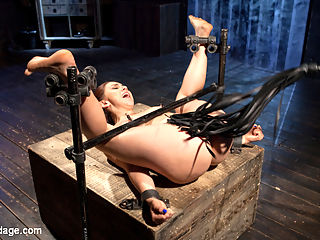 Pushing Her BUttons : Mandy arrives ready and begging to make her day as intense as possible. I have no problem pushing the buttons of the willing slut, so I oblige her. The first position shows her that its going to be a long day of grueling bondage and non stop torment. She is flogged as tries to get through the first position. The next position is more of a challenge as she is upside down with her legs spread to full open up her pussy. The torment starts immediately and then I realize that he pussy is soaking wet and ready to get filled. I start working my hand inside her pussy, but cant quite get the entire fist inside of her. We move into the final position and have her on her back with her legs spread further than before. Once I realize that my fist just will not fit, I turn back to tormenting this whore. Before Im finished with her, I remove her from the final device and give her some good old fashion manhandling. I want to see her suffer and I refuse to stop until I get what I want from her.