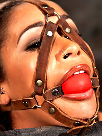 Penthouse Pet, Skin Diamond, in Devastating Bondage : We begin with Skin sitting in our chair with her amazing ass on display. Her head is trapped in a leather head harness that will get pulled back to an anal hook, but that comes later. First she is tormented with a heavy flogging and her nipples are clamped and weighted down. Next we fulfill one of her long time fantasies, which is to be mummified. She is helpless as she lies on the floor, with only her mouth left unwrapped. She is toyed with, her pussy violated and her breath held in her captors hand. Her feet are caned and then she is pulled into a hogtie and left on the floor struggling.Skin has an amazing body, so we put her in a single leg inverted suspension. She hangs helplessly and anxiously waiting for the next round of pain. her nipples are abused and she is flogged more, bringing her closer to her breaking point. She earns another orgasm, and then there are more that are not really what her sensitive pussy wanted at all.We fold her in half in a pile driver position and start to fuck her slutty pussy. That isnt enough, so we fuck her face and then takes turns going between the two willing holes. Her soles are tormented and then she is made to cum more.