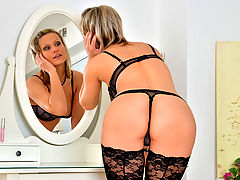 Tall blonde milf shows off her body and finger fucks her wet pussy on her vanity