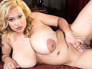 The Incredibly Big Bra Show : A sensation since her debut in late 2014, the great Liza Biggs is back in The Incredibly Big Bra Show. One look at Liza and its instant wood. Her rack is unbelievable and real, amazingly real. She does it all from solo nude to sex with a dude and she does it so well, youd think shed been modeling for years. Shes confident and comfortablebr br In that treasure chest on the floor are things that busty girls hold dear. Reaching in, Liza pulls out a collection of bras to dip her own treasure chest into. Theyre just too small. None of them fit her 36JJJ-cups. Her breast-flesh spills out on the sides. They spill over the cups. They spill under the cups. The camera moves in close. Lizas big boobs fill the screen. Its hooter heaven.br br Tossing each bra over her shoulder when shes done trying to squeeze into them, Liza gives us a fantastic naked knocker show and then works her way down to rub her lady nub, fingers plunging deep into the pink, her sheer black panties pulled to the side. br br When Lizas show is over, tears of joy run down the tit-lovers cheeks and he looks up to give thanks for the natural miracle that is Liza Biggs. br