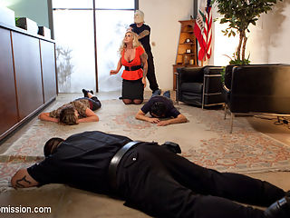 The Hostages : When a bank robbery goes wrong, Tommy Pistol takes hostages. Sexy MILF bank manager Ryan Conner and hot young newbie Goldie are taken to an abandoned warehouse and tied into inescapable bondage and fucked into submission. Featuring hardcore domination and submission with Tommy fucking two gorgeous captives, including sloppy face fucking, ass licking and hard anal.