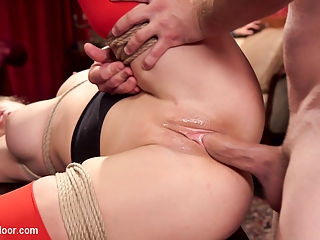 The Anal Initiation of Mystica Jade : Gorgeous and petite slave initiate Mystica Jade has submitted herself to the will of The House, with her asshole as an offering. MILF senior slave Cherie Deville is on hand to lead our initiate by her tight little nipples around the crowd to show off the goods. Mystica blushes as Phoenix Marie spanks her round ass and offers her blow job pointers. With such a tiny throat it is a wonder she can fit the Butlers fat cock all the way in, but Miss Deville provides a wonderful example and has her trainee stuffed full of hard dick in no time. Submissive blow jobs and exhibitionism arent all it takes to be a slave. Cunning and strength are needed, and Mystica is put on the spot to answer questions and hold heavy trays so that her Senior Slave can enjoy a good fucking at the hands of the Butler. For such a tiny girl Mystica is determined and struggles through several screaming orgasms while holding position before dropping her trays. Naturally she apologizes to Miss Cheries denied pussy with a sloppy series of kisses. The final Hours of the night find our initiate trapped on her back, legs spread wide, rope tied tightly around her as the Butler and Miss Deville explore her ass with cocks and fists until the crowd is satisfied she has paid her dues and allow both slaves on the furniture to finish milking the Butlers balls and entertaining the House with a series of nipple and clit torment games.