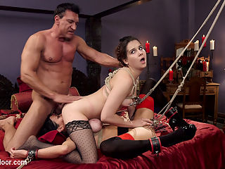 Nymphomaniac Slave Punished with Double Pounding : House Maid Warner is sent to turn down the beds and makes a terrible error when she finds the lead nympho slave in a strict rope deprivation punishment. Veronica is practically slavering all over her tightly bound tits. Its been two weeks since she was last given sex, and she will do anything to get it. Once she manages to make herself enough of an obstacle to cleaning that she must be untied, Veronica jumps the maids nubile young pussy and gets her fill of innocent flesh. Master Banderas comes in to find his deprivation experiment ruined and his slutty MILF subjects fist deep in the maids trapped pussy. Sexual punishment is due, and both the maid and the nympho slave will be subjected to a thorough and violent fucking. Tits tied tightly, clamps applied painfully, and fists deep in tight asshole and wet cunts squirting, these women get more sex than either of them bargained for, leading to Banderas new experiment Can a nymphomaniac MILF ever get filled with enough cock? Watch to find out.