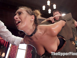 Fresh 19 Year Old Tied Tight and Made to Serve Orgy : Ashley Adams is everything The Upper Floor could hope for in a trainee slave big bouncy natural tits, sexual hunger, a willingness to learn, and a perfect ass. However, this little slut cannot learn the rules to save her own hide! The first scene she is has her fresh young pussy lashed to the sybian vibrator and is grilled by some of our sadistic female guests on the rules. The Steward is roundly humiliated as trainee Adams tries to get out her predicament by bouncing her juicy tits and sucking cock, but its not enough and she is made to have screaming punishment orgasms and has her sensitive nipples tormented with electricity and clamps with the hope that the pain will help her remember. When the party moves to the lounge the guests show us the meaning of orgy, covering the furniture with a wild BDSM sex free for all. In the midst of all this sex, Ashley is put in her first suspension ever and handed over to two of our finest slaves from the first days of TUF Nerine and Iona. These women stalk Ashley like cats of prey, beating her tender flesh and teasing her trapped pussy with a vibrator. In the end, Ashley fails once again to remember the rules and is hit many times with the cattle prod while she writhes in the air and begs for mercy. Its time to break out the big guns, and our guest of honor John Strong is called in to feed Ashley some positive reinforcement in the form of a hard fucking in the stocks while The Steward applies some painful clamps and a few instructions of how to remember the rules. This mix seems to do the trick, and Ashley finally can recite the rules and follow them while having her 19 year old pussy mercilessly fucked. After so much embarrassment for the House, The Steward puts Ashley in a strict cowgirl and burns her sweet young thighs out as she sweats and works for every orgasm. If there is a perfect vision of desperation to please, it is the visage of this young lady by the end of the 
