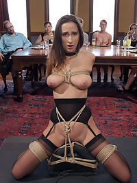 Fresh 19 Year Old Tied Tight and Made to Serve Orgy : Ashley Adams is everything The Upper Floor could hope for in a trainee slave big bouncy natural tits, sexual hunger, a willingness to learn, and a perfect ass. However, this little slut cannot learn the rules to save her own hide! The first scene she is has her fresh young pussy lashed to the sybian vibrator and is grilled by some of our sadistic female guests on the rules. The Steward is roundly humiliated as trainee Adams tries to get out her predicament by bouncing her juicy tits and sucking cock, but its not enough and she is made to have screaming punishment orgasms and has her sensitive nipples tormented with electricity and clamps with the hope that the pain will help her remember. When the party moves to the lounge the guests show us the meaning of orgy, covering the furniture with a wild BDSM sex free for all. In the midst of all this sex, Ashley is put in her first suspension ever and handed over to two of our finest slaves from the first days of TUF Nerine and Iona. These women stalk Ashley like cats of prey, beating her tender flesh and teasing her trapped pussy with a vibrator. In the end, Ashley fails once again to remember the rules and is hit many times with the cattle prod while she writhes in the air and begs for mercy. Its time to break out the big guns, and our guest of honor John Strong is called in to feed Ashley some positive reinforcement in the form of a hard fucking in the stocks while The Steward applies some painful clamps and a few instructions of how to remember the rules. This mix seems to do the trick, and Ashley finally can recite the rules and follow them while having her 19 year old pussy mercilessly fucked. After so much embarrassment for the House, The Steward puts Ashley in a strict cowgirl and burns her sweet young thighs out as she sweats and works for every orgasm. If there is a perfect vision of desperation to please, it is the visage of this young lady by the end of the day Sweating, eyes wide, slutty mouth open, tits bouncing, and pussy full of cock, begging to cum. Well Done Ashley!