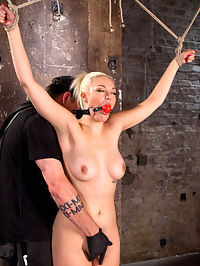 The Marilyn Monroe of Porn in Tight Bondage with Extreme Torment and Orgasms!!! : In walks this blond bombshell that looks like Marilyn Monroe, dressed in a red dress, bright red lipstick and a body to die for. We get her tied up as fast as possible to ensure that she doesnt escape. She is still new to all of this, so we ease her into it with her hands above her head in a classic position to match her look. Throughout the day we maintain this same feel with traditional bondage positions, yet increase the torment to a level that has this slut spitting and screaming. The orgasms are powerful that make her weak in the knees and keep her on the edge all day.