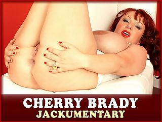 Jackumentary Cherry Brady : A list of Cherry Bradys DVDs and magazines is proof of her popularity. Letters continue to come in asking for the redheads return, or just any unpublished photos or videos. Shes a charmer, bright and charismatic, and that comes through on film.br br The big-boobed natural, a staunch enemy of breast reduction and a fan of iSCOREi and Voluptuous models, was a Voluptuous magazine subscriber way before she decided to send in her own photos at home to see if The iSCOREi Group was interested in her. Cherry was immediately invited to model.br br Cherry began in the traditional way. First nude and toy scenes. Five months later, she decided to try boy-girl action. She conceived and wrote the script for the movie Ultimate Cherry with Angela White and Brandy Talore. B.L.O.W. The Busty Ladies Of Oil Wrestling was next with Cherry, Brandy, Angela and Annie Swanson for the wild naked wrestling extravaganza. This was a dream cast.br br Cherry never sought out other studios. She was content with her relationship with TSG. After a hiatus from modeling, Cherry briefly returned just as sexy and stacked.br br I tried my hand at mainstream acting. You know, mostly I got cast in parts like junkie whore or topless extra. The main thing that I didnt like about that is that they wanted me, ME! to do simulation. I dont do simulation so I had to come back so I can do penetration. I have just been living my life. I have a very adventurous life. I like to get out there and do all sorts of stuff. I like to dirt bike ride, camp, hike, travel and scuba dive. I like to see where the road takes me. I like to get into stuff. I usually get in trouble!br br Now retired at least for the present time!, fan favorite Cherry is a busty legend.