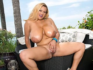 Busty Bikini Baby : The way Liza Biggs wears that bikini brings tears of joy to a mans eyes. It must be a state-of-the-art, well-engineered bikini top to support her bountiful treasures. Its also nice to see Liza outdoors in a lush setting.br br Lizas trimmed down a bit but her big boobs remain the same. She has the kind of natural spot-reducing metabolism that ignores her tits. Not many busty girls are so blessed breast size usually yo-yos with weight gain or loss.br br Liza calls herself a Bl-erman. Shes black and German. Big boobs run in her family. All the females have big breasts. I have the biggest boobs in my family, says Liza. My cousins, aunts, grandma, they all have big boobs.br br Liza collects her iSCORELANDi scenes on her computer. She said when she first modeled, she wasnt sure what to expect. But now her confidence has increased as shes gained more experience readers compliments and comments have also helped.br br Liza appears as a guest on the first episode of SCOREtv season 2 in a tight, low-cut dress that requires a permit to wear in public.