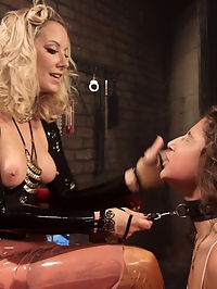 Slave to Desire Maitresse Madeline dominates 19-year-old lesbian anal slut! : 19-year-old Abella Danger stumbles upon Maitresse Madelines advertisement for her telephone domination services. Driven by desire she meets up with the dominatrix for an incredible, personal session. Madeline hardly spares her. Instead she unleashes a barrage of punishing domination filled with spanking, bondage, finger banging, pussy licking, a zipper and brutal anal strap-on fucking! Abella is unable to resist as shes bound to a wall, then tied up in bed and fucked, all the while enduring one punishment after another!