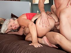 Jeannie Lous DP Adventure : Oh, two nice cocks today, white-haired, 63-year-old mother, grandmother and divorcee Jeannie Lou says at the start of this scene as she strokes the guys through their pants. One in my pussy, one in my ass. Which one do I do first? Or do I get both of them?br br You get both of them, Jeannie Lou.br br Its so fucking hot. So juicy, she says.br br So hot and slutty. Thats Jeannie Lou, who hopes to one day open a brothel. Considering how much she loves cock, we figure she wont just be running it.br br By the way, turns out she gets both of the cocks at the same time, one in her pussy, one in her ass. Its double-penetration time.br br Jeannie Lou is a nudist and a swinger. She once told us, I do a lot of threesomes at home. She also told us that she views life as an adventure. This is Jeannie Lous DP Adventure. Enjoy. She did.