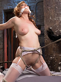 Red Headed Anal Queen is Helpless in Grueling Bondage : Penny finds herself tied to a bed on her knees. This is how we like to see the girls around here anyway, its where they do their best work. Her clothes are removed and used as a gag to keep this slut quiet. She s a little bit too saucy so to remedy that we issue corporal punishment. Next we display her best asset and before the punishment comes her gaping asshole beckons to be filled. The Pope tries to make her hungry asshole the first he has ever fisted, but even this sluts magical ass couldnt handle his fist.In the final scene she is on the floor and spread in a very vulnerable position. She is tickled and choked then made to choose her next punishment. Her feet are caned, she screams and then is pulled in the air for a full inverted spread eagle. Her pussy is fucked and she is made to orgasm one final time.