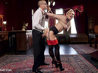 Nerdy College Girl Turned Depraved Anal Slave : Nickey Huntsman is a precocious Human Sexualities major coming to the darkly sensuous Upper Floor to study female submission and the BDSM lifestyle. Dahlias pleasure in consensual sexual slavery and desperate need to let the Butler have his way with her gorgeous body and mind beguile the young student. Soon Nickeys glasses are off and her eyes are wide as she is inducted into the slave lifestyle. Hard cock shoved deep in her throat and ass as she learns to play the power games and keep her fellow slaves pussy happy while she takes her punishment flogging. Nickeys empathy gets in her way, and she finds herself holding silver trays attached to Dahlias nipple clamps and getting fucked after her dress is cut away from her perfect body. In the slave training collar she has her round ass beaten and her face used to please Dahlias pink pussy. Both slaves have their asses fucked and shocked in turn by the Butler until Nickey learns to beg like a depraved slave for the cum.