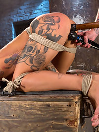 Stunning Tattooed Babe Made to Endure Torment in Brutal Bondage : We begin with Kleio standing and her ares bound at the wrists and elbows. She is stripped and then tormented with flogging and spankings before being made to cum. I decide that she is going to fly. She is suspended for the first time ever in an inverted hogtie with her arms stretched out and tied to bamboo. She endures more brutal beatings, heavy pussy torment and then she is made to cum again. Next we showcase Kleios amazing ass. Her entire body is on point and she works her ass off to keep it that way. She is spanked, flogged and her feet tormented before we fuck her into submission.In the final scene she is on her back with her hands and feet pulled in different directions to make her back arch. Her body is stretched out making her helpless and vulnerable. She is flogged more, made to endure extreme breath control, and finger banged. The vibe is introduced and her mind gets blown as she begs for the orgasms to stop.