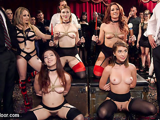 Hot Kinky Slave Orgy : Its all tits and asses on deck as two senior slaves teach two dick hungry newcomers how to fuck, suck, and suffer like a true slave girl. Its Folsom Street Fair, the kindest wildest BDSM celebration in the world, and The Upper Floor is full of hot lifestyle players and kinky swingers filling the room with rope suspensions, hot sex, whips cracking, and submissive players moaning. James Mogul and Aiden Star have their hands full with with these sexy little submissives trying to use their bouncing tits and round asses to keep themselves out of trouble and on the cock, but no party would be complete without some pain with the pleasure. Newbie Joseline Kelly finds out that a sensitive clit can be too much of a good thing as beautiful dominant women from the crowd torment her wet pussy with a vibrator while she latched down to a table. Savnnah Fox has her firm ass tied up tight like a christmas ham and fucked hard while Ella Nova and Ember Stone try to suck cock with skill and fortitude, but find themselves under the punishing flogger of their Governess Aiden Star. Joseline really shines when her perfect little pussy is trussed up and fucked as she learns how to beg and beg and beg for the multiple loads Marco pills on her pretty face... look forward to footage from our second camera in part two coming soon.